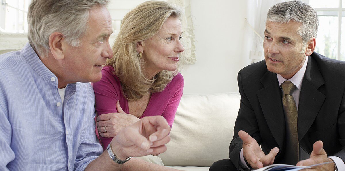 couple meeting property valuer
